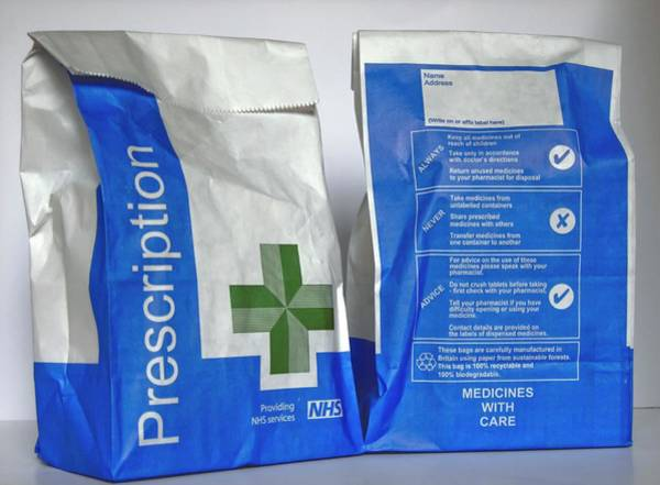Branding Photograph - Nhs Prescription Bags by Ian Gowland/science Photo Library