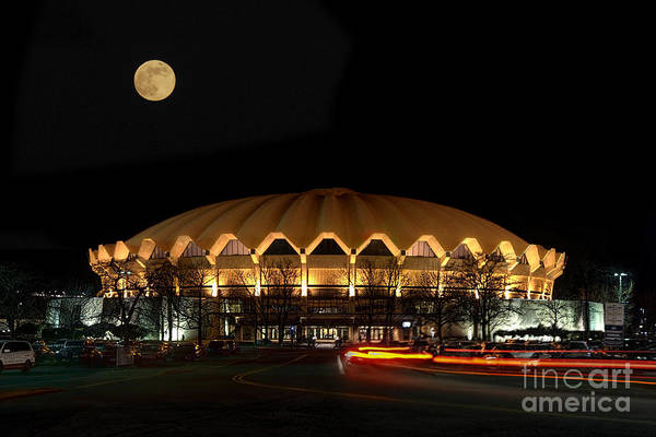 Photograph - night and moon WVU basketball arena by Dan Friend