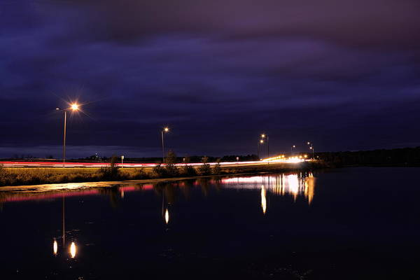 Photograph - Nighttime Over Mccleary Bridge by Dale Kauzlaric