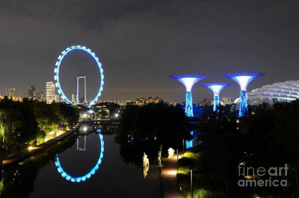 Night Shot Of Singapore Flyer Gardens By The Bay And Water Reflections Art Print