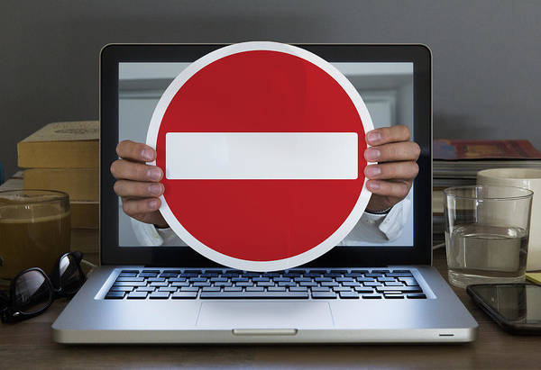 No Entry Sign Appearing Out Of Laptop Computer Art Print by Dimitri Otis