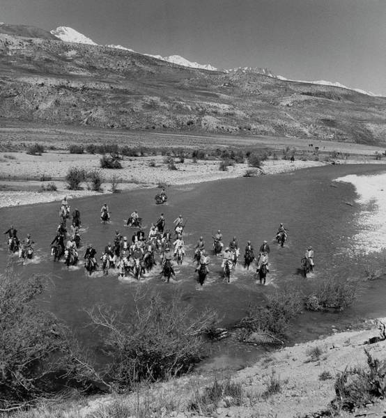 Group Of People Photograph - Nomadic Tribesmen Cross A River In Iran by Horst P. Horst