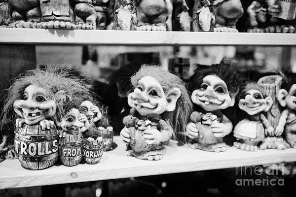 Troll Photograph - norwegian trolls souvenirs for sale in a gift shop Tromso troms Norway europe by Joe Fox