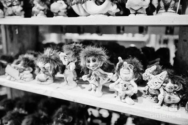 Troll Photograph - norwegian trolls souvenirs for sale in a gift shop Tromso troms Norway by Joe Fox