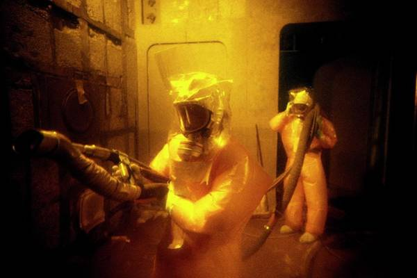 Radiation Wall Art - Photograph - Nuclear Decontamination Workers by Patrick Landmann/science Photo Library