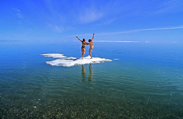 Exuberance Photograph - Nude Young Couple Playing On An Ice by Stephen Gorman