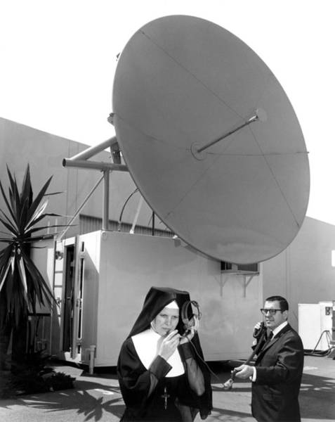 Satellite Dish Photograph - Nun Listens To Satellite by Underwood Archives