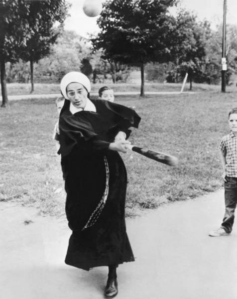 Wall Art - Photograph - Nun Swinging A Baseball Bat by Underwood Archives