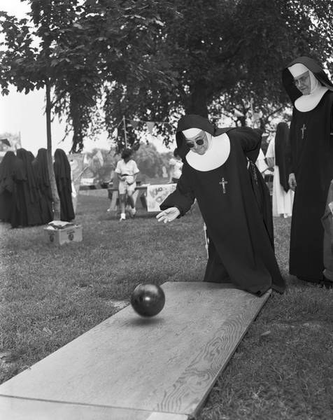 Ten Pin Bowling Wall Art - Photograph - Nuns Bowling by Underwood Archives
