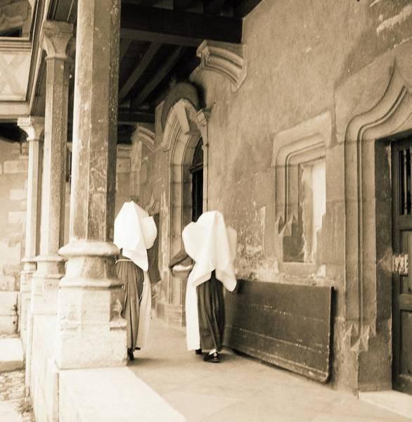 Habit Photograph - Nuns Walking by Horst P. Horst