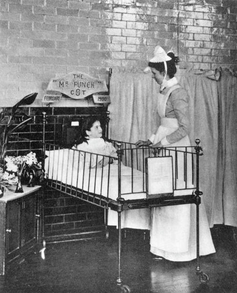 Wall Art - Photograph - Nurse At Gt Ormond St Hospital Tends by Mary Evans Picture Library