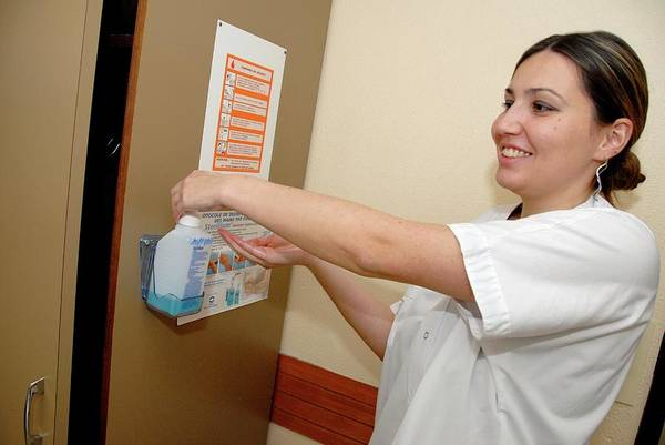 Wall Art - Photograph - Nurse Cleaning Hands by Aj Photo/science Photo Library