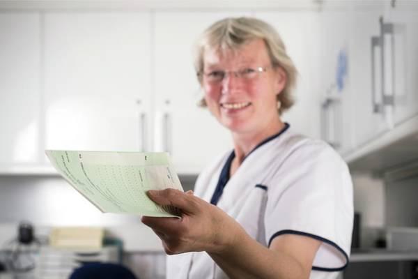 Nurse Photograph - Nurse Handing Out Prescription by Jim Varney