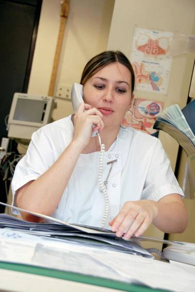 Wall Art - Photograph - Nurse Using A Telephone by Aj Photo/science Photo Library