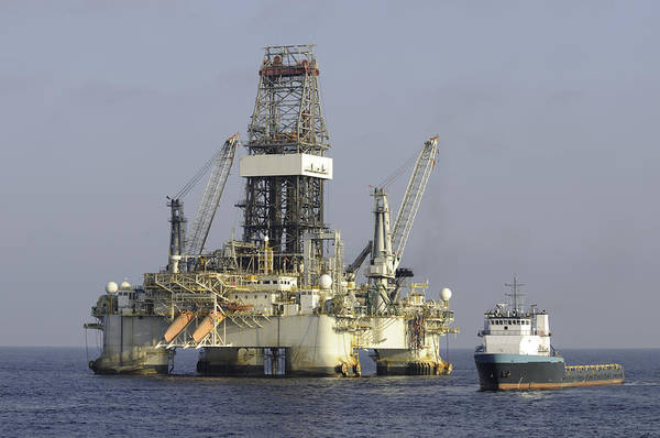 Photograph - Ocean Oil Rig With Supply Boat by Bradford Martin