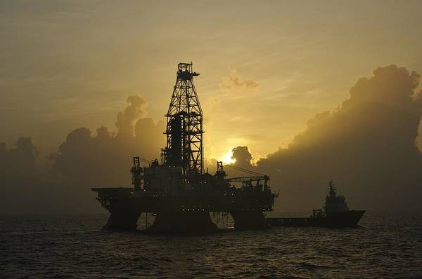 Photograph - Offshore Oil Rig With Sun And Clouds by Bradford Martin