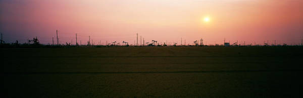 Pump Jack Wall Art - Photograph - Oil Field At Sunset, California State by Panoramic Images