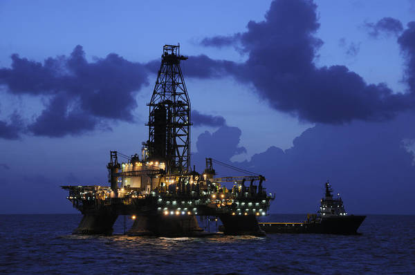 Oil Rig And Vessel At Night Art Print