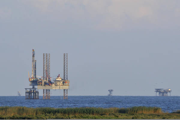 Photograph - Oil Rig Vewed From Shore by Bradford Martin