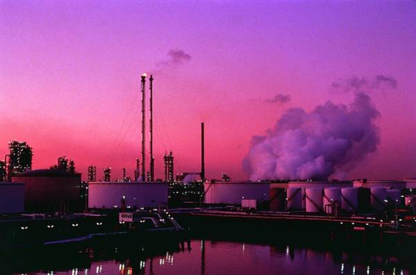 Wall Art - Photograph - Oil Storage Tanks And Refinery by David Parker/science Photo Library