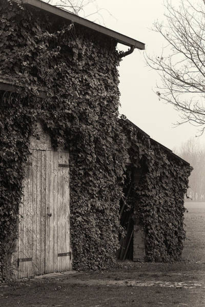 Barn Photograph - Old Barn With Wooden Doors Closed by Fotosearch