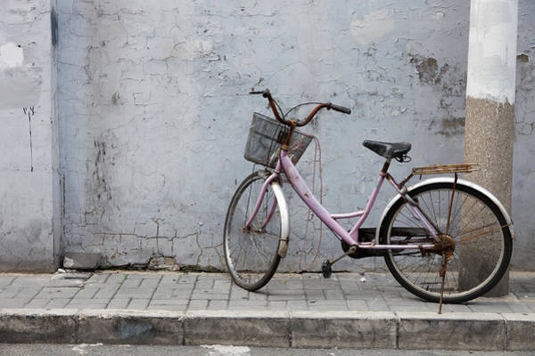 Bicycle Photograph - Old Bicycle On Village Street by Cultura Exclusive/roberto Westbrook