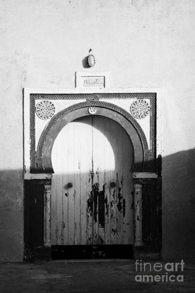 Hammamet Photograph - Old Blue And White Painted Doors Entrance To Islamic House In Traditional Ornate Style by Joe Fox