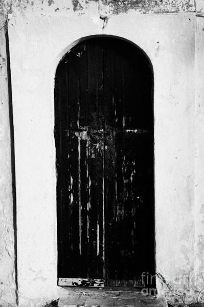 Hammamet Photograph - Old Blue Painted Traditional Archway Doors Of A Whitewashed House In Hammamet Tunisia by Joe Fox