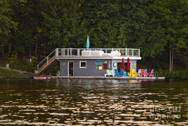 Photograph - Boathouse With Colorful Chairs by Les Palenik