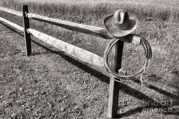 Roping Photograph - Old Cowboy Hat On Fence by Olivier Le Queinec