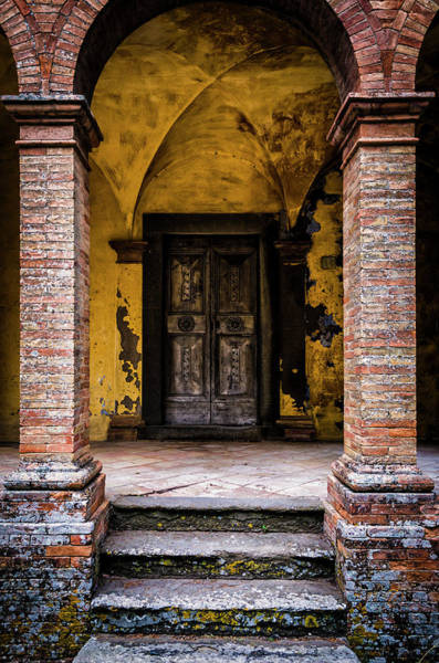 Brick Wall Photograph - Old Decorated Wooden Door In A Ghost by Ardenvis