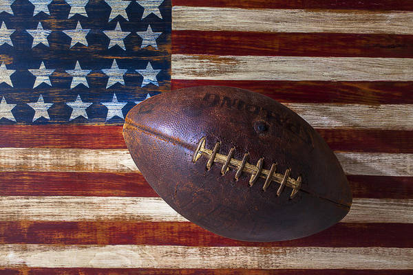 Landmarks Photograph - Old Football On American Flag by Garry Gay