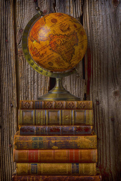 Rare Earth Wall Art - Photograph - Old Globe On Old Books by Garry Gay