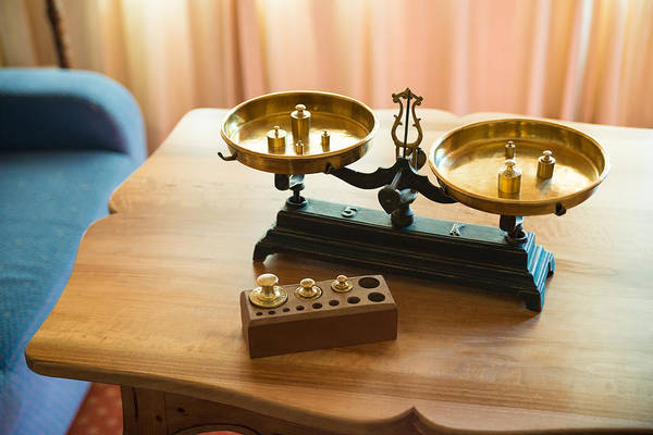 Photograph - Old Golden Pair Of Scales With A Set Of Weights by Matthias Hauser
