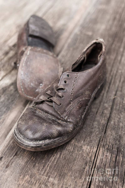 Yesterday Photograph - Old Leather Shoes On Wooden Floor by Edward Fielding
