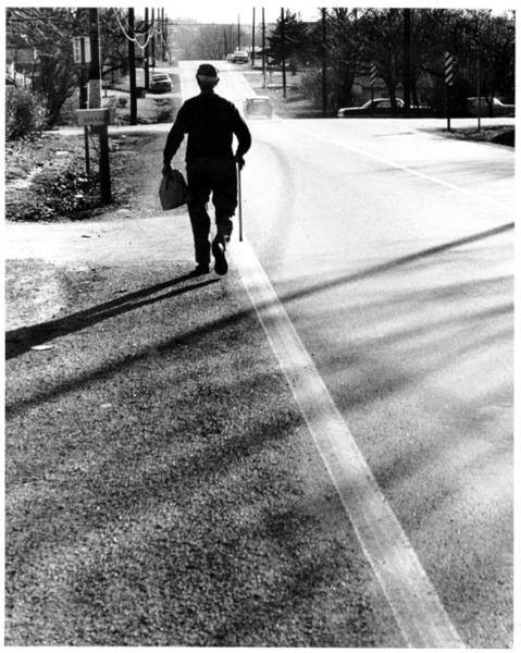 Wall Art - Photograph - Old Man On His Way Home by John Lautermilch