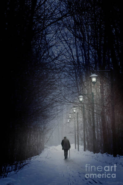 Photograph - Old Man Walking On Snowy Winter Path At Night by Sandra Cunningham