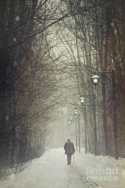 Photograph - Old Man Walking On Snowy Winter Path by Sandra Cunningham