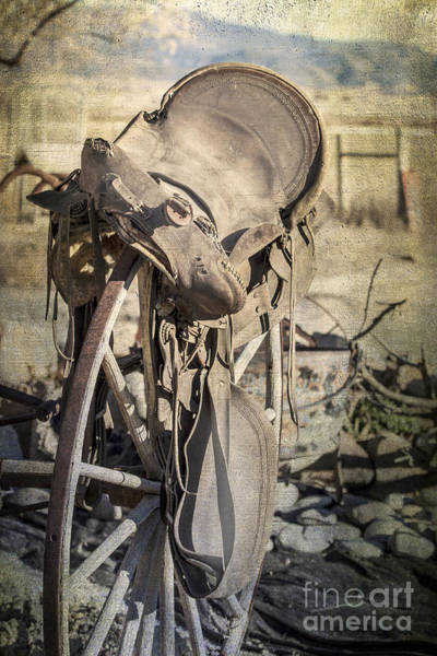 Crazy Horse Photograph - Old Saddle On Wagon Wheel by Janice Pariza