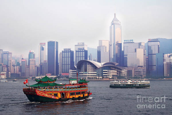 Wall Art - Photograph - Old Traditional Chinese Junk In Front Of Hong Kong Skyline by Lars Ruecker