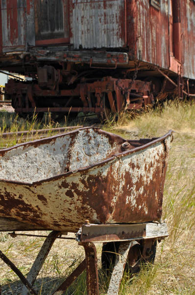 Photograph - Old Wheelbarrow And Great Northern Pacific Boxcar by Bruce Gourley