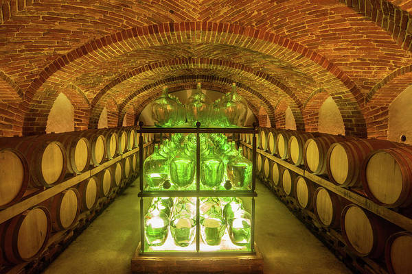 Bottle Photograph - Old Wine Cellar With Barrels And Bottles by Seppfriedhuber