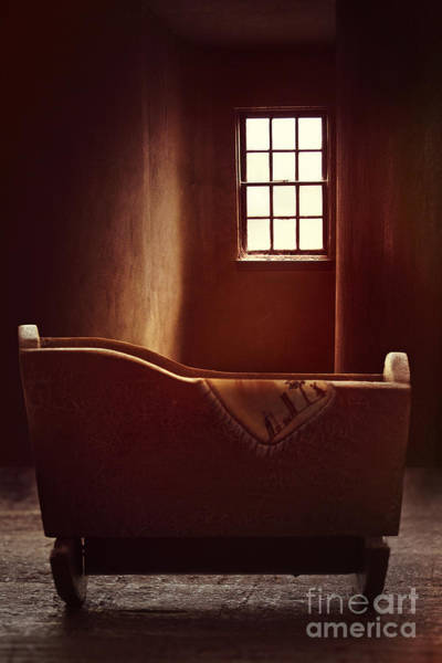Photograph - Old Wooden Cradle In A Red Light Filled Room by Sandra Cunningham