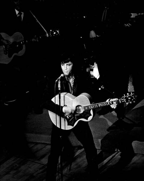 Controversy Photograph - On Stage Elvis Presley Trills The Crowd by Retro Images Archive