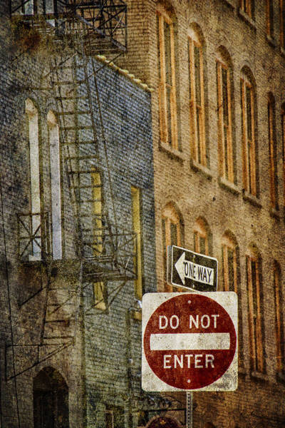 Photograph - One Way And Do Not Enter Signs In Front Of High Rise Building With Fire Escape by Randall Nyhof