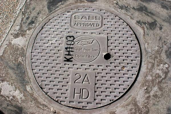 c011a0e16 Manhole Wall Art - Photograph - Optic Fibre Manhole Cover In Cape Town by  Mark Williamson