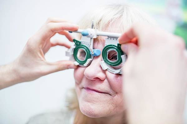 Senior Photograph - Optometrist Performing Eye Test by Science Photo Library