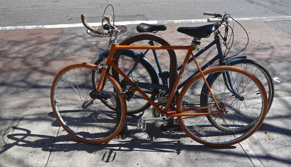 Photograph - Orange And Blue Bikes by Joan Reese