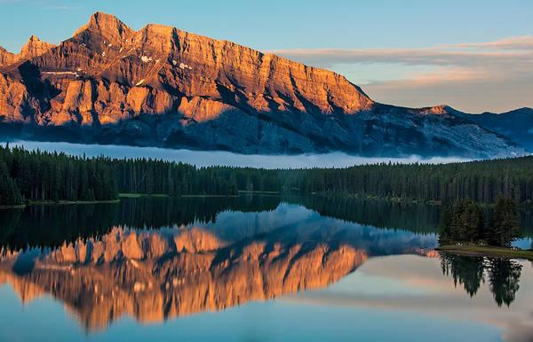 Wall Art - Photograph - Orange Mountain Reflection In Lake Minnewanka by James Wheeler