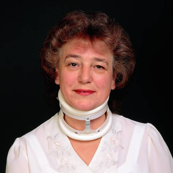 Neck Brace Photograph - Orthopaedic Neck Collar On A Woman (summer) by Alex Bartel/science Photo Library